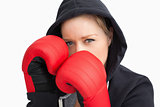 Woman with hoodie boxing