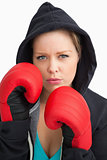 Woman showing her boxing gloves