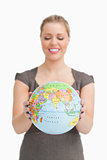 Woman looking a globe
