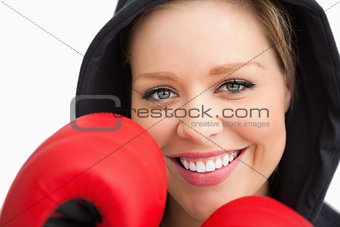 Woman smiling boxing