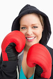 Pretty smiling woman boxing