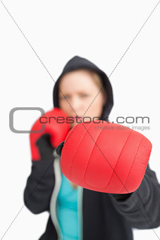 Woman boxing with a red gloves