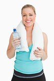 Woman holding a towel around her neck