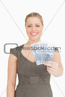 Woman showing her euro banknotes