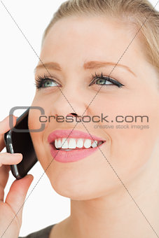 Close up of a pretty woman calling