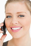 Woman smiling calling with her smartphone