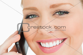Close up of a woman calling with her smartphone
