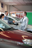 Man shaking the hand of a salesman
