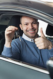 Smiling man holding car keys