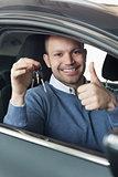 Smiling man holding car keys