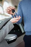 Woman receiving keys from a man