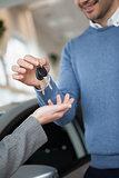 Smiling man holding keys