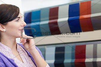 Woman smiling while wondering what color to choose