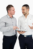 Two men together while holding a tablet computer
