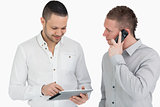 Two men calling and using a tablet computer