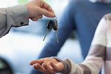 Car dealer giving keys to a customer