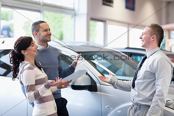 Couple chatting with a salesman
