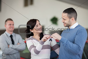 Couple holding keys while looking at each other