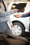 Salesman handing keys to a customer