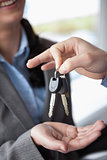 Woman smiling while receiving keys