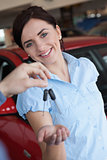 Woman smiling and receiving car keys
