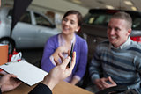 Couple listening to a car dealer