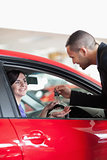 Smiling woman receiving car keys