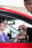 Woman smiling while receiving car keys