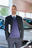 Man standing beside a car
