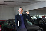 Salesman holding car keys