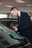 Salesman looking inside the car