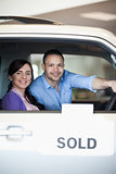 Couple in a sold car