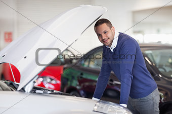 Man leaning over a car