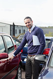 Man holding a car handle while holding a file