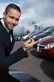 Man holding car keys with a finger
