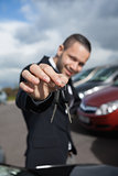 Happy businessman holding car keys