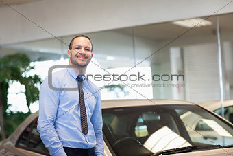 Man standing between cars