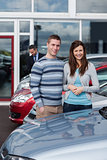 Couple choosing a car
