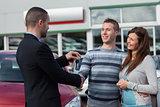 Man shaking hand with salesman