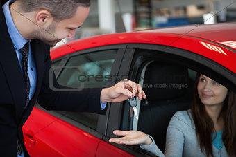 Client receiving car keys