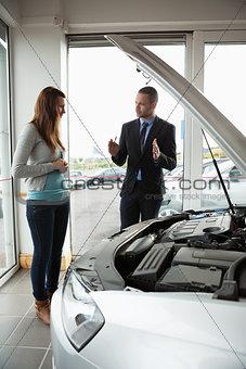 Businessman presenting a car to a woman
