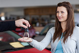 Woman receiving car keys in his hand