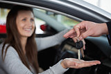 Happy woman receiving car keys