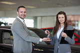 Woman giving car keys to a man
