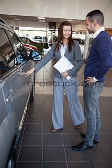 Woman holding car handle