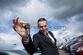Happy seller holding car keys