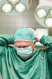 Surgeon putting on a face mask on his head