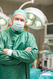 Surgeon crossing his arms while standing