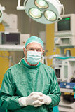 Surgeon smiling while crossing his hands