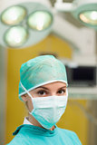 Woman standing and wearing a surgical gear